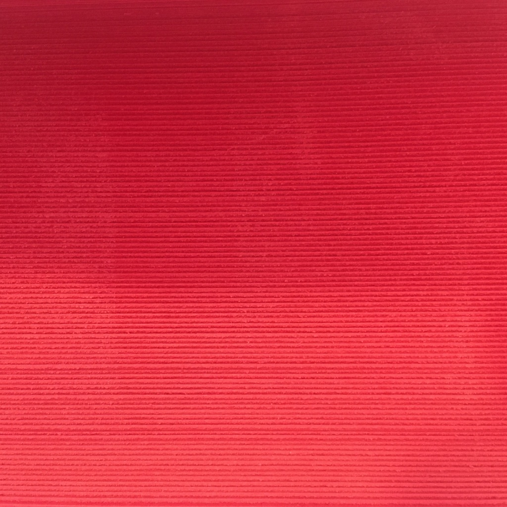 Close up image of a stack of red paper.