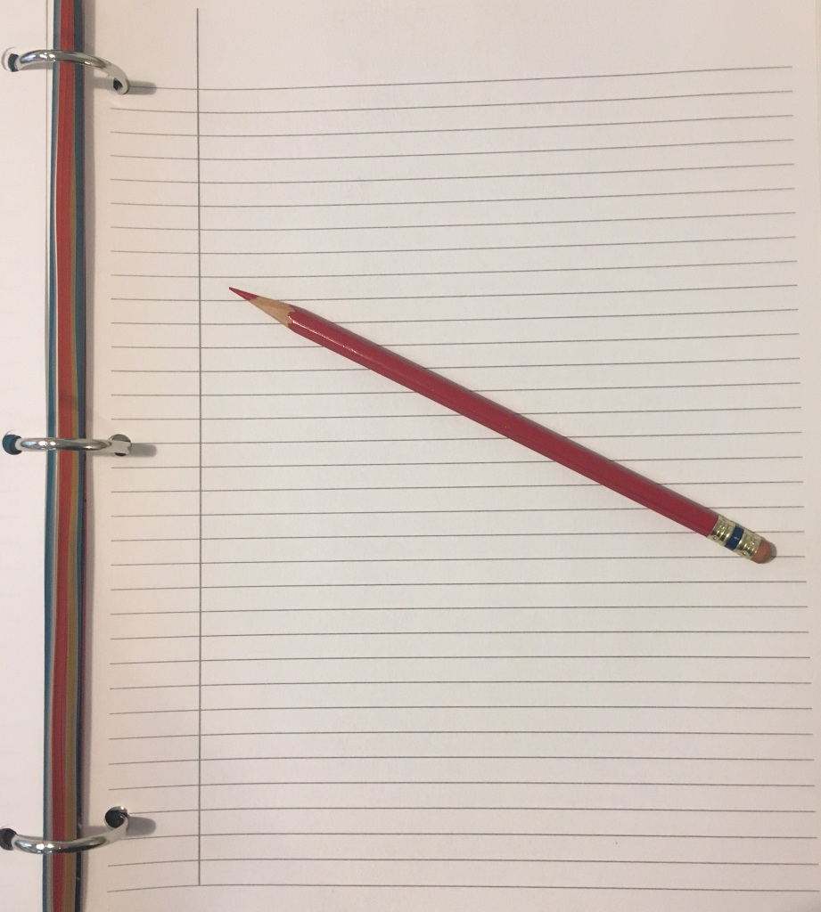 A piece of lined paper with a pencil