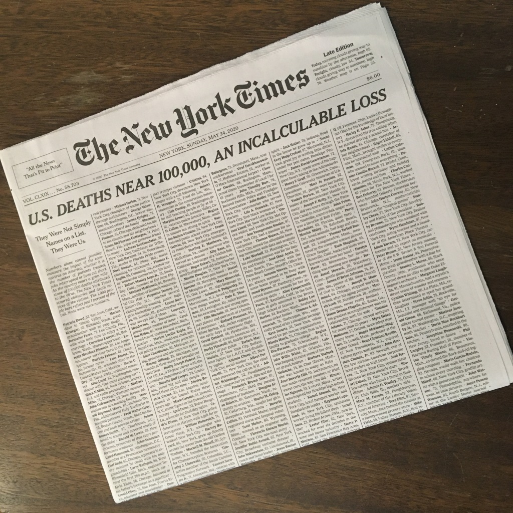 """An image of the New York Times from May 24, 2020 with the headline """"U.S. DEATHS NEAR 100,000, AN INCALCULABLE LOSS""""."""