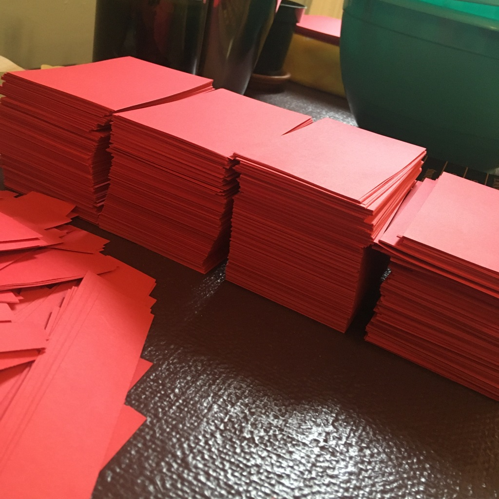 Stacks of red pre-cut paper